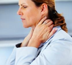 woman suffering from severe neck pain